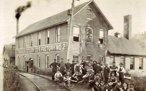 an early picture of Cattaraugus Cutlery, note the railroad tracks next to the building