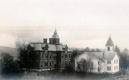 Cattaraugus Union Free School and Academy in about 1890. Constructed in 1887 the building was destroyed by fire in 1893. M.E. Church next to school